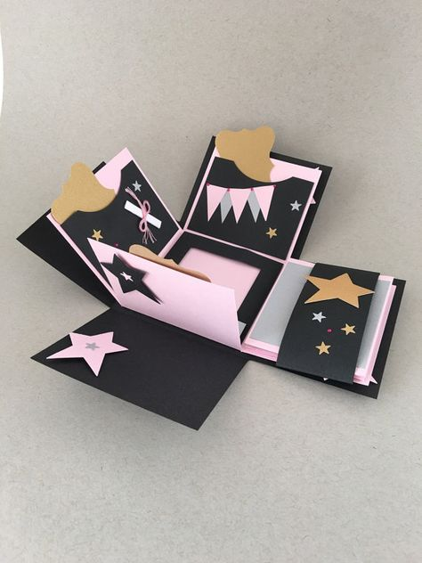 """Explosion Photo Box - Graduation Photo Album - Graduation Memory Album - Exploding Box Album - Grad Cap and Tassel - Pink, Black, Gold and Silver School Graduation 3D album  This listing is for One (1) Exploding Photo Box as shown, Pink  This is called an explosion album due to when you take the lid off; the pages unfold and explode outwards reveling flaps that have small pages for photos and pockets with removable tags.  ......Details of box......  Box size is approx. 4 x 4 square 3"""" in heig..."""