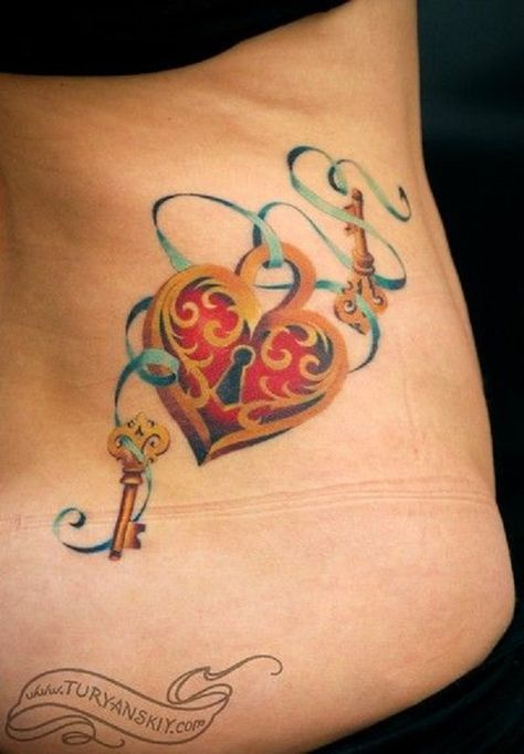 A simple yet eye catching lock and keys tattoo design. The sky blue ribbon loops around the lock and the chain enters the keys by the loops. You can also notice that the lock is in a heart shape.