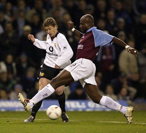 Burnley 0 Man Utd 2 in Dec 2002 at Turf Moor. Ole Gunnar Solskjaer passes through the legs of Arthur Gnohere in the League Cup 4th Round.