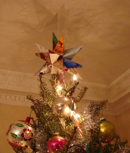Tree topper/ star made from old Christmas cards.