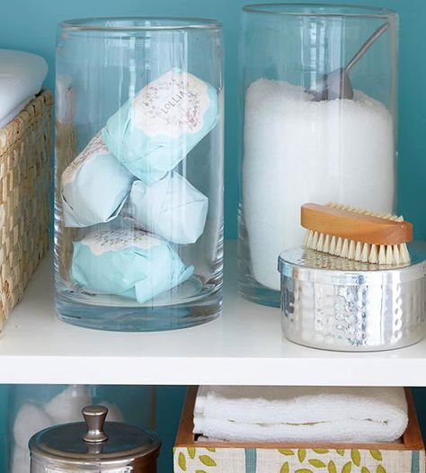 Clear storage containers look pretty and are functional! http://www.bhg.com/decorating/storage/organization-basics/creative-ways-to-organize-a-linen-cabinet/?socsrc=bhgpin012315useclearstorage&page=2