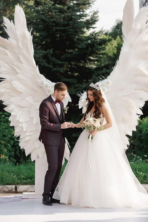 Giant angel wings white - background at the wedding ceremony, party, outdoor wedding decoration, wedding photo zone, wing decor, trends 2021