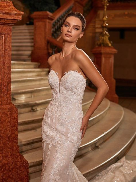 Let your inner goddess shine in Val Stefani Style Dolce. This sexy strapless gown features a sweetheart neckline and re-embroidered lace appliques that dazzles with each step you take. To see more details from this form fitting mermaid silhouette, head to the link now! #weddingdress #mermaidweddingdress #laceweddingdress #weddingdressideas