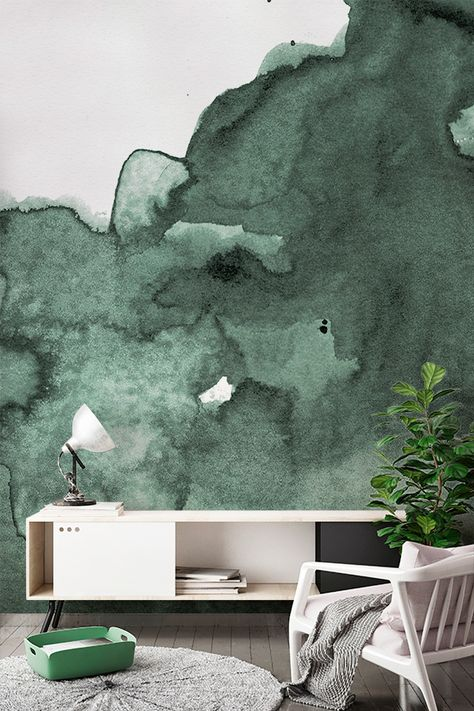 Wash away your worries with inky watercolor hues. This stunning wallpaper design captures smokey emerald tones that add allure and sophistication to your living room spaces. Pair with neutral furnishings for a totally relaxed feel.