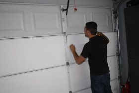 Lowes sells garage door insulation for keeping cold and heat out.