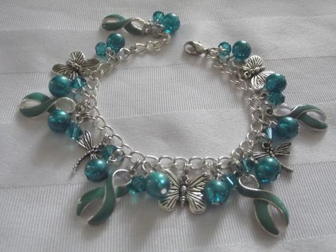 Teal awareness butterfly and dragonfly charm bracelet!