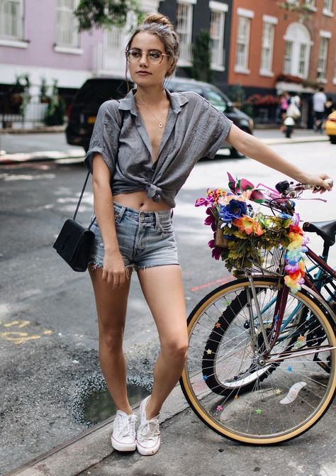 Summer attire knock out a shirt paired with denim shorts