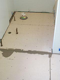 Final Sheets Of Hardibacker Fastened To Bathroom Subfloor