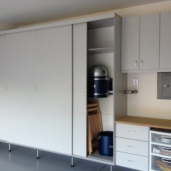 Garage Cabinets Are Made With Sliding Doors Which Saves Space Is