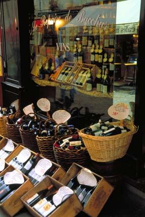 France    Bottles of Wine in Window