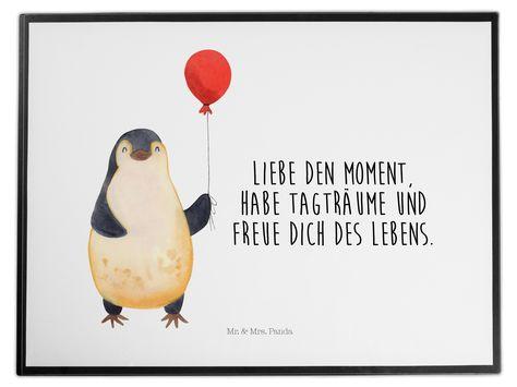 Schreibtischunterlage Pinguin Luftballon aus Kunststoff  Schwarz - Das Original von Mr. & Mrs. Panda.  Die Schreibtischunterlage wird in Deutschland exklusiv für Mr. & Mrs. Panda gefertigt und ist aus hochwertigem Kunststoff hergestellt. Eine ganz tolle Besonderheit ist die einzigartige Einlegelasche an der Seite, mit der man das Motiv kinderleicht gegen andere Motive von Mr. & Mrs. Panda tauschen kann.    Über unser Motiv Pinguin Luftballon      Verwendete Materialien  Wir verwenden ausschließl