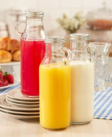 Use this Set of 3 Milk Bottles as beverage pitchers on the table or to store liquids in the refrigerator. Each bottle has a handle that makes it easy to grab and pour. The metal lid helps keep the contents fresh.