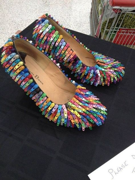 Zipper tabs applied to shoes.