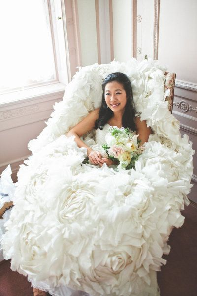 a bride in a sea of Monique Lhuillier roses  Photography by http://www.tinsparrowstudio.com/