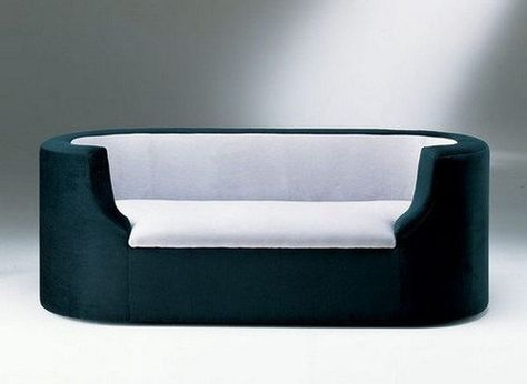 Pierre Chareau designed this sofa in 1923 for the set of Marcel L'Herbiers film L'Inhumaine. In 1925 it was also seen in the film La Vertige, another film of L'Herbier.