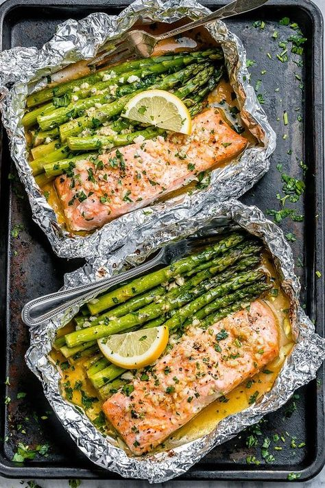 Salmon and Asparagus Foil Packs with Garlic Lemon Butter SauceWhip up this quick and delicious salmon recipe tonight! Salmon and asparagus are baked together with a rich buttery sauce