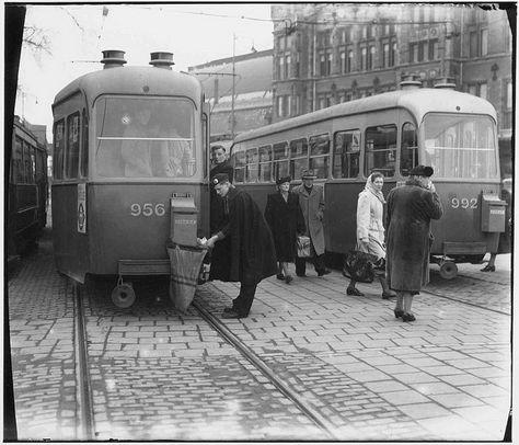 1951 Centraal Station, Amsterdam. PTT employee empties tram mail box. #amsterdam #1951 #centraalstation