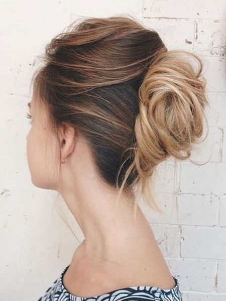 For an undone take on the classic French twist, sweep your hair from one side toward the crown of the head. Twist hair tightly, tuck ends under and secure with bobby pins. Gently pull pieces to loosen the twist, and add a spritz of texturizing spray.