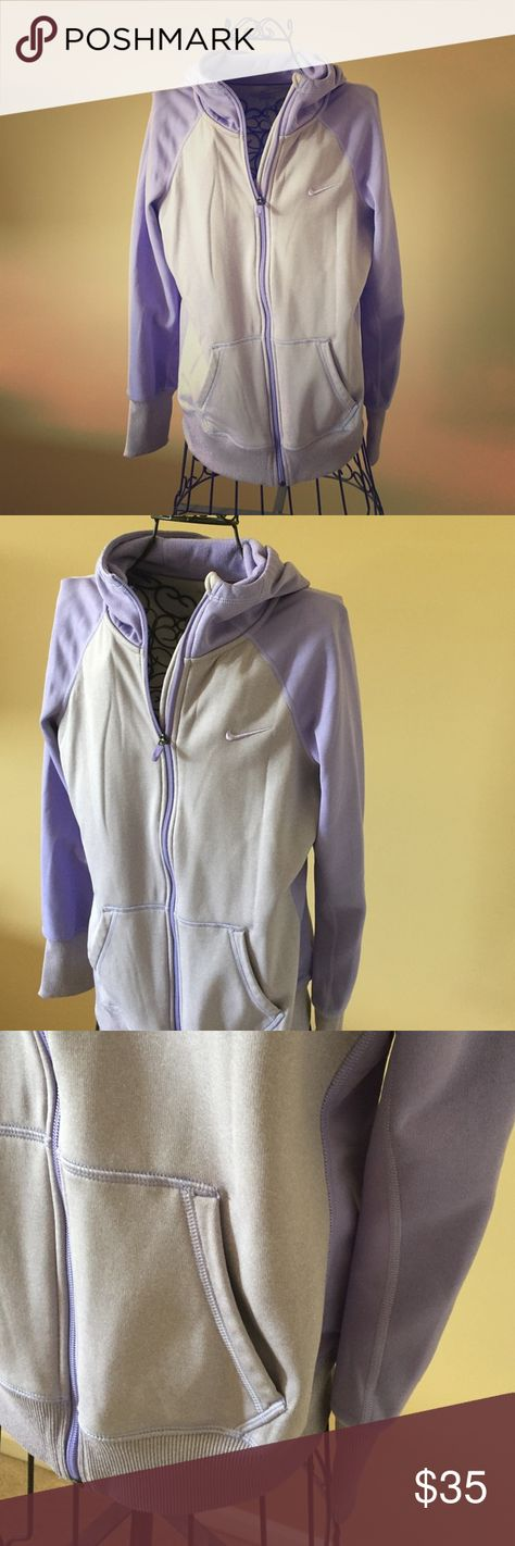 NIKE Purple Zip Up Hoodie Nike zip up hoodie is a purple two tone color. It has a hood on it and two pockets in the front.  It has been worn a couple times and there are no imperfections.   It is a women's medium in size. Nike Other