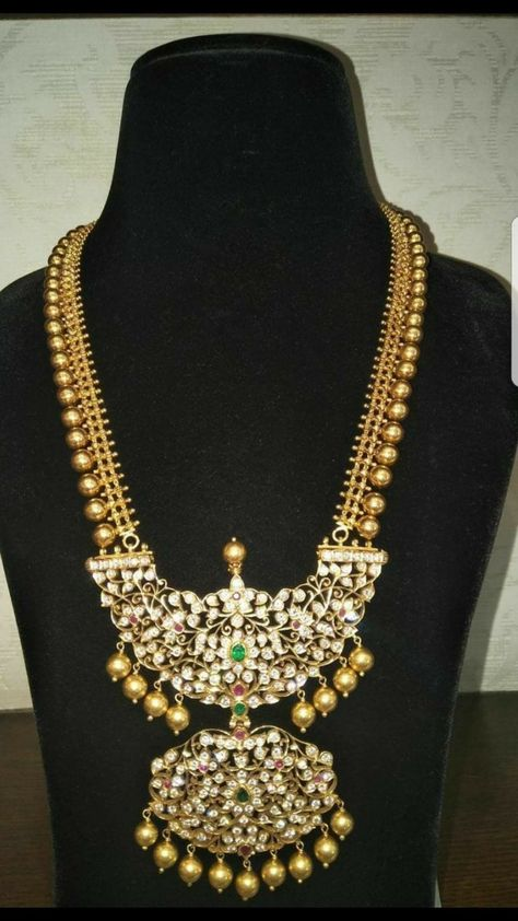 Large gold balls attached chain with patakam pendant. Antique finish long haram with two step kundan pendant in floral style from manjula jewels