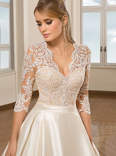 Beaded Mermaid Style Wedding Dress Deep Plunge Neckline And Low