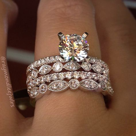 A unique idea for your wedding band. Keep adding to your engagement rings. One for your wedding day and keep adding everytime you have a child!
