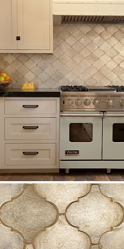 gray arabesque/moorish tile backsplash; black quartz counters ...