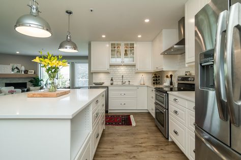 White IKEA kitchen with island in condo with Bodbyn doors - design by Christie Timperley
