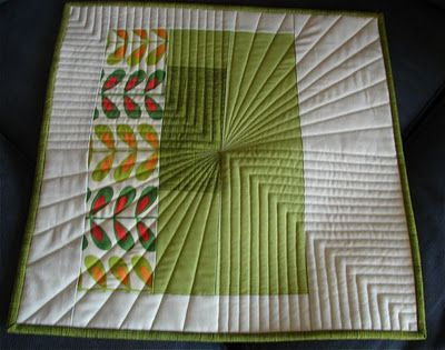 Straight line quilting with 2 designs meeting in center of block