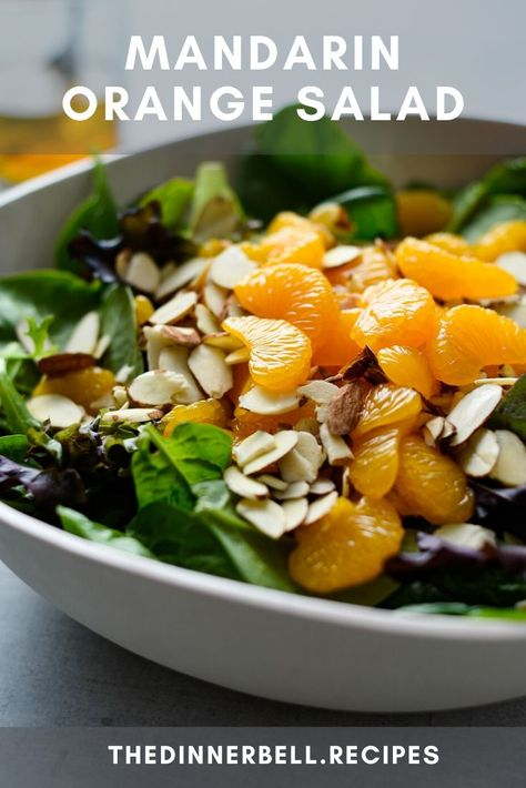 No slicing, dicing or chopping required! This Mandarin Orange Salad is the summer side dish that goes with everything. Sweet oranges, crunchy almonds and a zingy bite from a quick homemade vinaigrette that comes together in minutes.