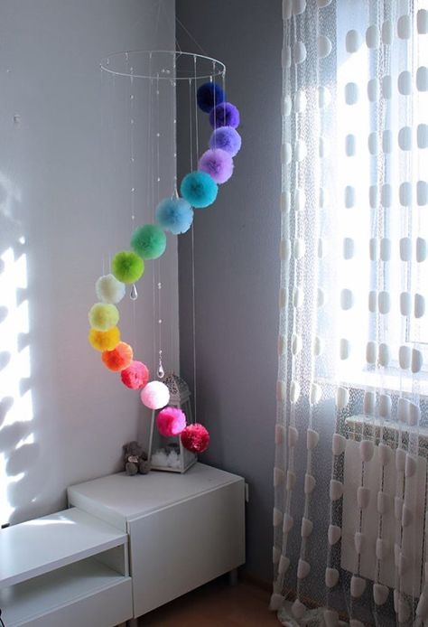 ☺ WELCOME This Huge Rainbow Mobile was made especially to become a beautiful addition to your Girl Room. Small crystals attached to the hoop diffuse the light creating unique visual show. Pom Pom hang in a cascade, one is lower than other. This Huge Mobile can be hang over the bed or in