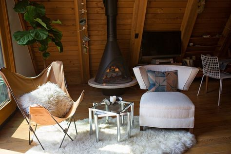 An Artist's 1963 A-frame Lux Lodge woodburning stove