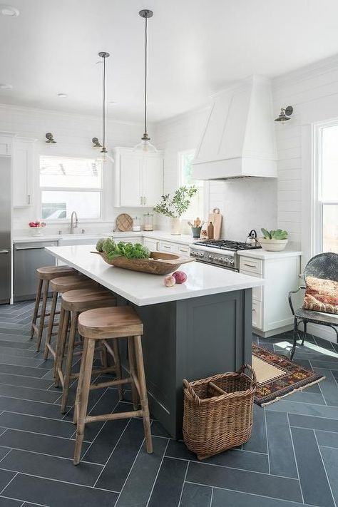 Four Wood Tractor Seat Counter Stools Sit On Gray Slate Herringbone At A Dark Gray Center Islan Kitchen Design Small Kitchen Layout Kitchen Island With Seating