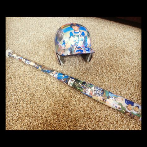 Bat an baseball helmet covered with pics from the season!  Better than a trophy any day!