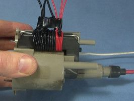 Flyback transformer primary and feedback coils wound on the