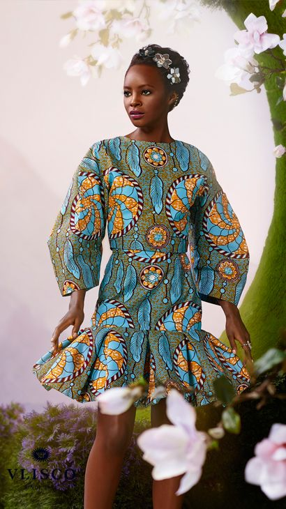 DREAMCATCHER | The rounded silhouette and structured tailoring recalls the work of early couture masters, while the playful placement of the 'dream catcher' print gives this outfit a contemporary spin. | Vlisco - The True Original | #vlisco #thetrueoriginal #dutchwax #waxhollandais #waxhollandis #ankara #ankarastyle #africanprint #africanprintfashion #africanfashion