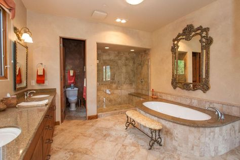 transitional master bathroom with complex granite counters