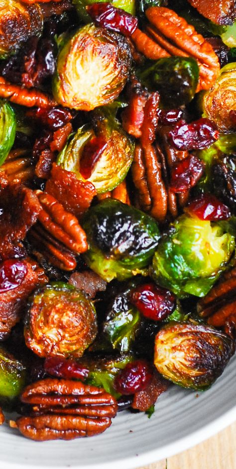 Brussels Sprouts with Bacon, Toasted Pecans, and Dried Cranberries is an easy Christmas side dish that will add colors and vibrancy to your holiday menu! #brusselssprouts #bacon #holidays #Thanksgiving #sidedish #salad #cranberries #pecans #nuts