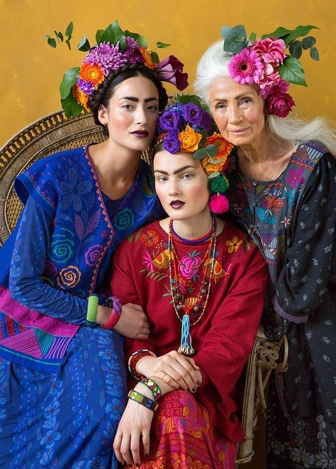 Frida Kahlo style times 3! It looks like 3 generations of colorfully adorned ladies. Come to our headdress class to make your own headdress...or purchase a hand-made headdress from us!