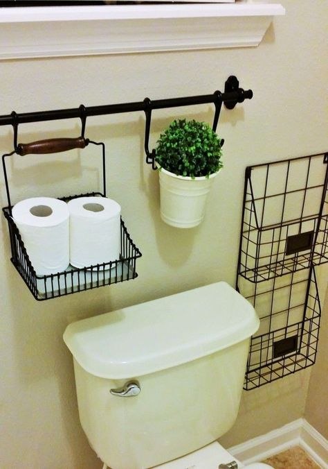 Wrought iron or brass curtain rods and home organizers in the bathroom! Always need a place for magazines....