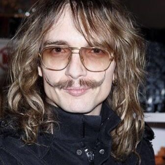 Justin Hawkins: Darkness frontman makes pact with Satan with help from voodoo man Doktor Snake.