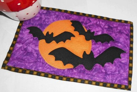 Halloween Bats Mug Rug by The Patchsmith | Quilting Pattern - Looking for your next project? You're going to love Halloween Bats Mug Rug by designer The Patchsmith. - via @Craftsy
