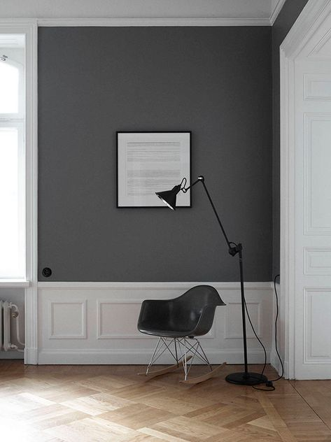 reading corner - Eames RAR rocker, parquetry timber flooring, grey painted wall and white decorative moulding