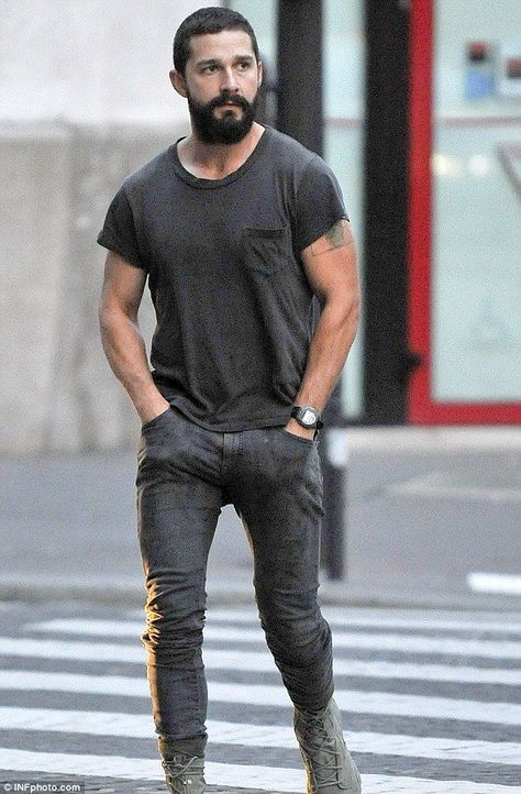 Shia LaBeouf cuts a lonesome figure smoking a cigarette in Paris Keeping his cool: Sporting his new trademark rugged beard, the actor dressed down in a casual grey T-shirt and a matching pair of skingtight jeans