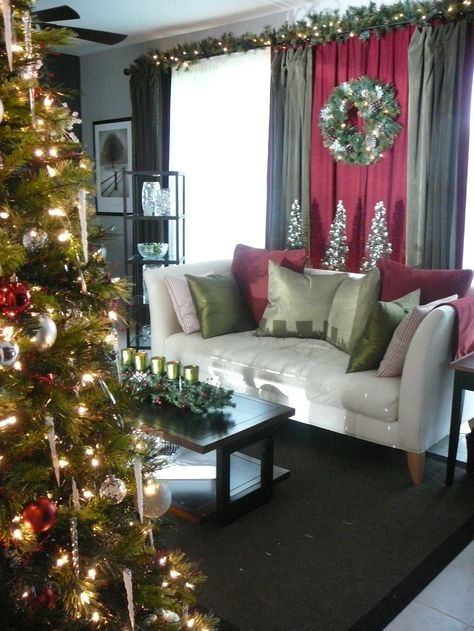 For Christmas Red And Green Curtains And Putting Garland Above The Curtain Rod Christmas Decorations Living Room Christmas Room Christmas Living Rooms