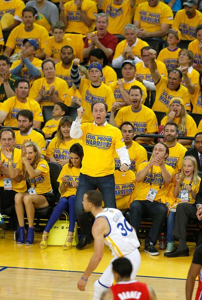 Description of . Golden State Warriors owner Joe Lacob, bottom center, celebrates a basket by Golden State Warriors' Stephen Curry (30) during their game against the Los Angeles Clippers in the first quarter in Game 6 of their Western Conference NBA Playoff game at Oracle Arena in Oakland, Calif. on Thursday, May 1, 2014. (Nhat V. Meyer/Bay Area News Group)