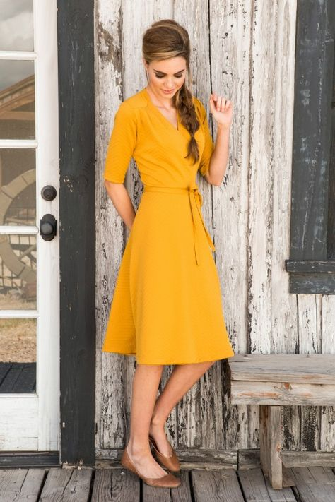Great mustard wrap dress.  Definitely needs some sprucing up with accessories.