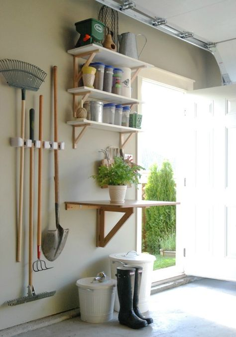 Organizing garden supplies and tons of other awesome ideas for organizing your garage! Love the drop down work space!