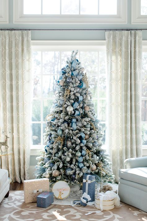 But if you truly want to stand out, we'd suggest you go for a blue Christmas tree this year. we've gathered a list of blue Christmas tree decoration ideas. Blue Christmas Tree Decorations, Elegant Christmas Trees, Silver Christmas Tree, Xmas Tree, Christmas Home, Christmas Ornaments, Christmas Trends, Christmas Mantles, Victorian Christmas