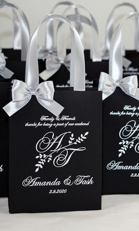 Elegant Wedding Monogram Welcome bags with satin ribbon handles, bow and your names. Silver Personalized Wedding gifts and favors for guests. #weddingbags #weddingwelcomebags #welcomebags #weddingwelcome #giftbags #partyfavor #weddingfavor #weddingfavors #weddingfavour #personalizedgift #weddingwelcome #weddingparty #weddingdecor #elegantwedding #thankyoutag #destinationwedding #welcomeletter  #silverweddingdecor #mrandmrs #elegantparty #silverwedding #weddingmonogram #blackandsilver